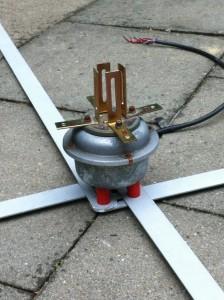 Rotor mit Abstandshalter auf Blechlaschen